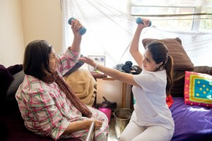 Photo of therapist teaching woman fall-preventing exercises